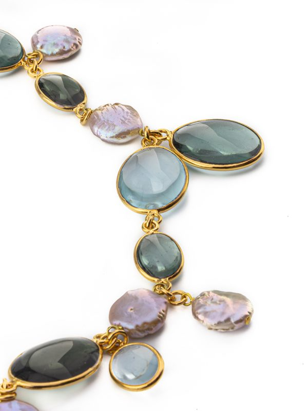 This long necklace is handcrafted from 24k gold plated brass and ornamented with pebbled crystals.